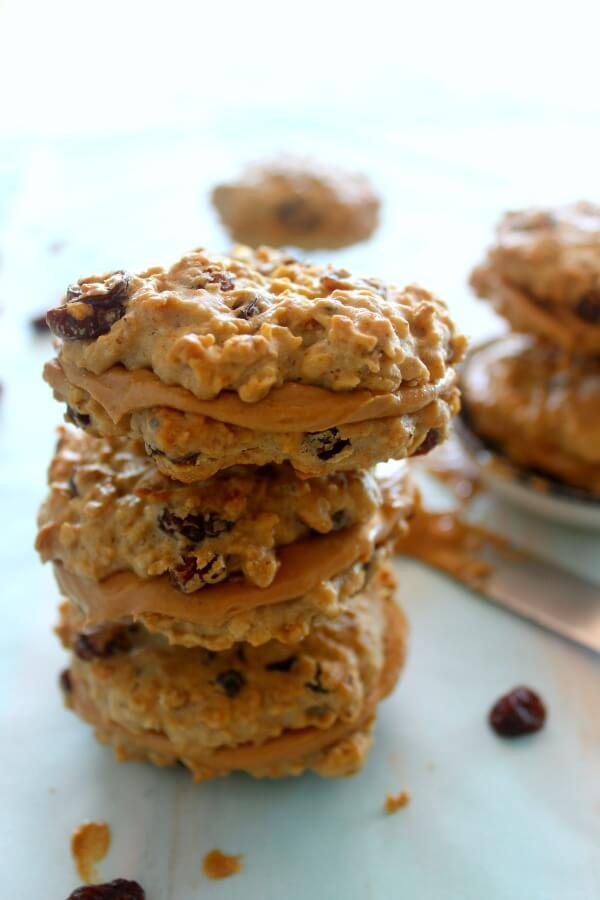 Oaty Raisin Peanut Butter Sandwich Cookies. Healthier oatmeal brown flour & raisin cookies with a peanut butter filling. A delicious snack or tea time treat. Your kids will love these! | berrysweetlife.com