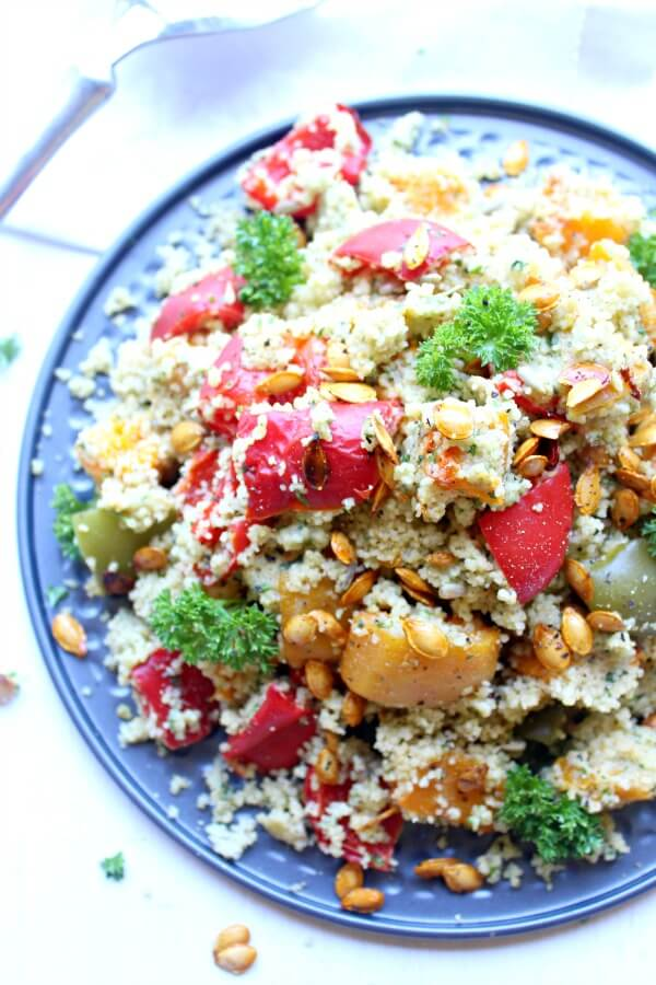 Roasted Butternut Squash Cous Cous Salad with Pesto Dressing. An easy, healthy vegetarian salad that is bursting with colour and flavour. You can't go wrong with this healthy dish!   berrysweetlife.com