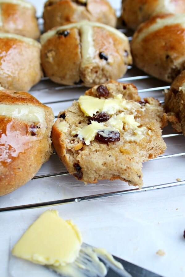No Knead Easter Hot Cross Buns. The best, easy homemade Hot Cross Buns for Easter - Soft & fluffy, full of spices & raisins with a honey glaze. YUM! | berrysweetlife.com