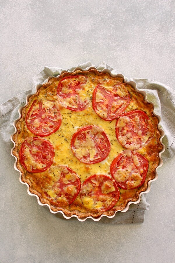 Easy Cheese Crust Tomato Quiche. A no roll, press down cheese and herb crust with a layered tomato and cheese egg filling. Simply YUM! | berrysweetlife.com