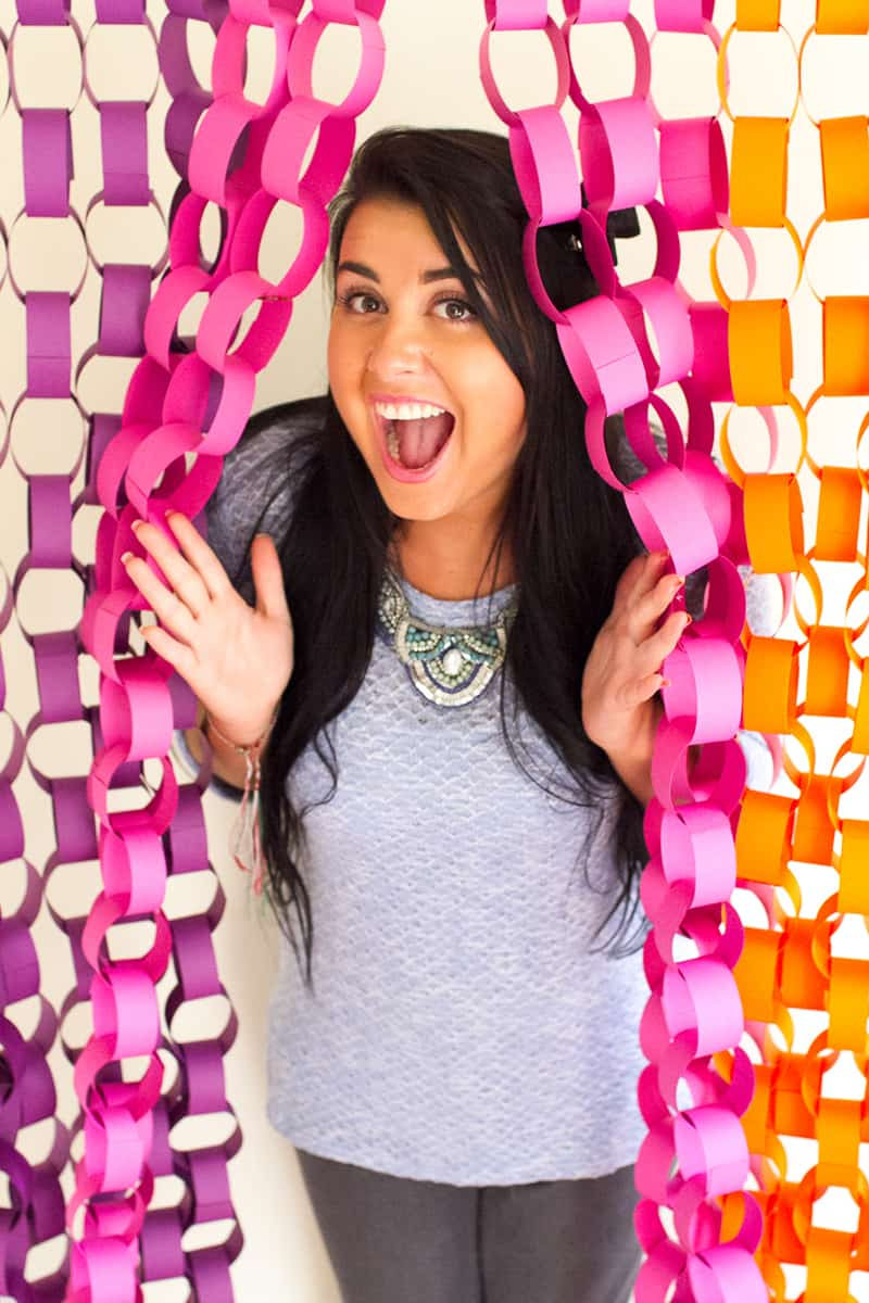 Colorful Paper Backdrop woman in the middle | DIY Photo Booth Ideas For Your Next Shindig