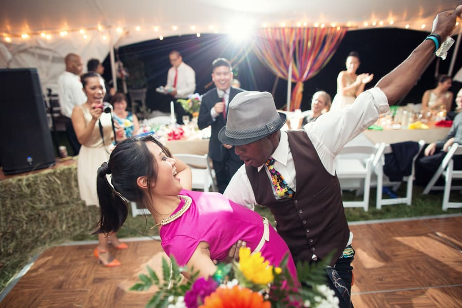 DIY Wedding with Coloruful Pompoms and rainbow backdrop Dancing