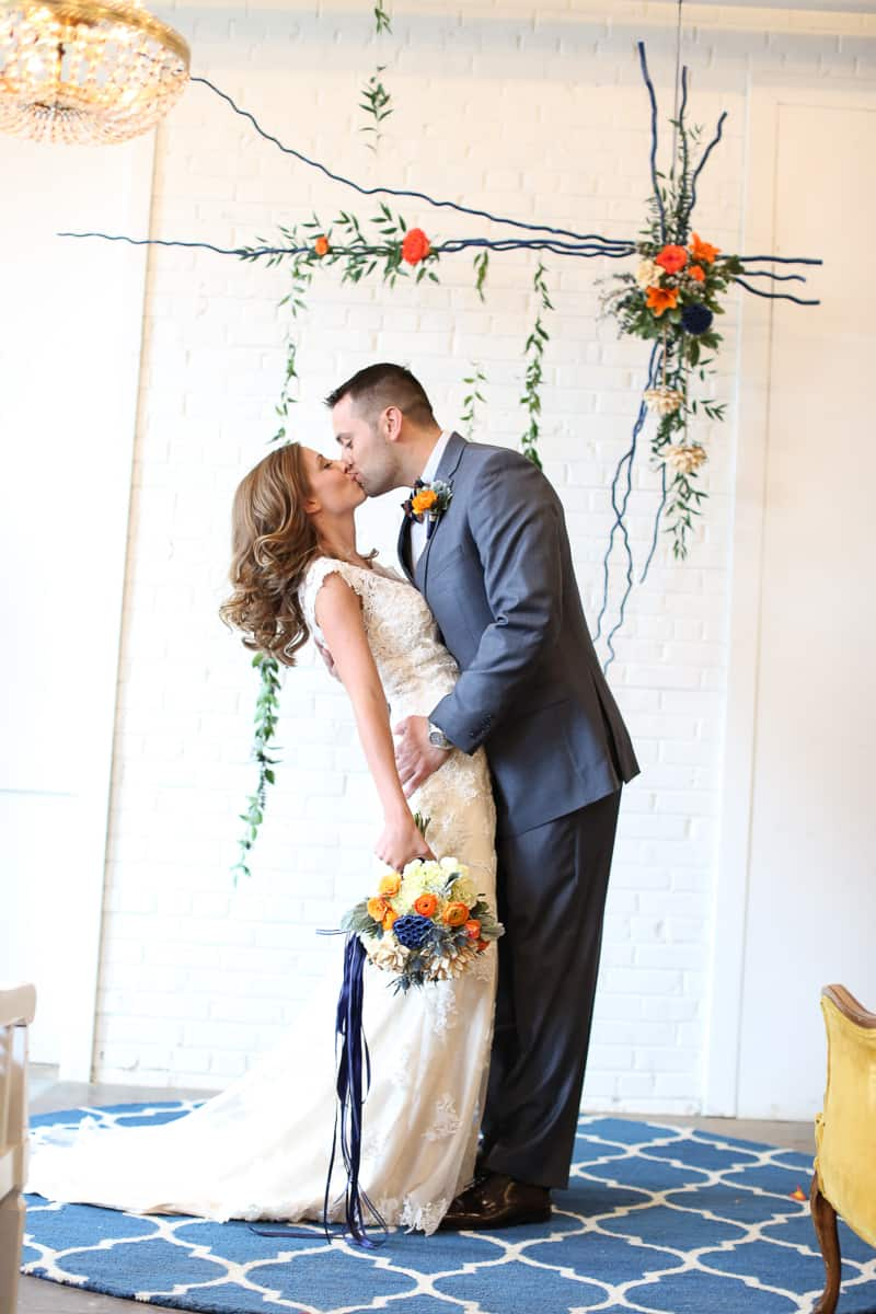 Whimsical Warehouse Wedding Inspiration with Bath tub bride orange navy colour scheme-5