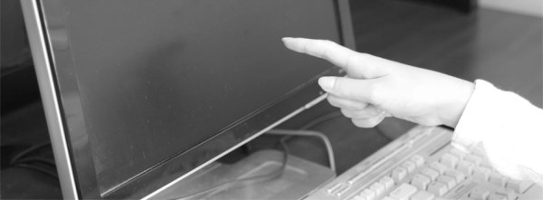 Image of finger pointing at computer