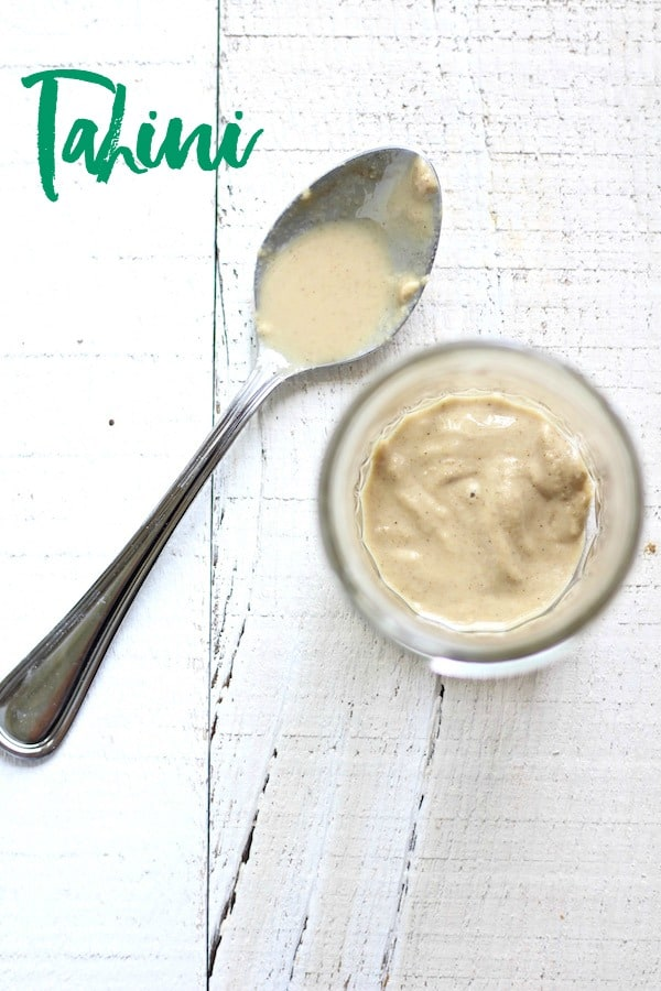 tahini in mason jar with text