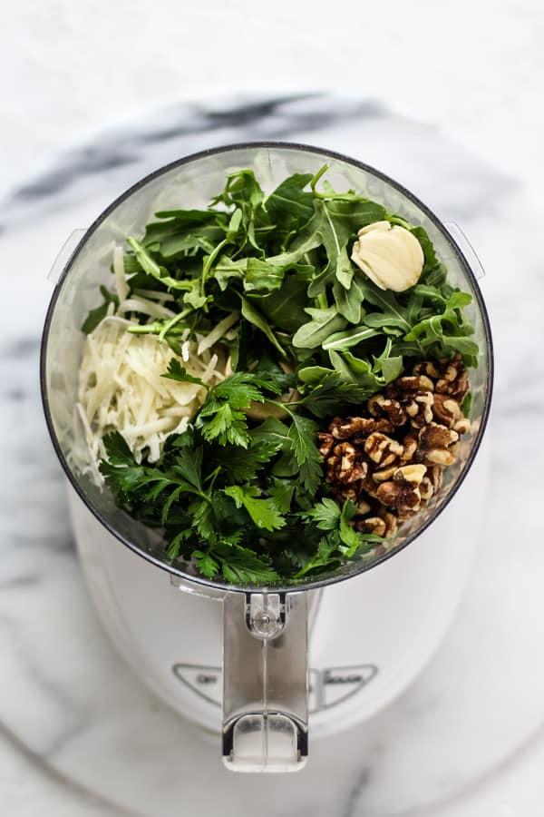 Arugula Parsley Pesto ingrdients in a food processor