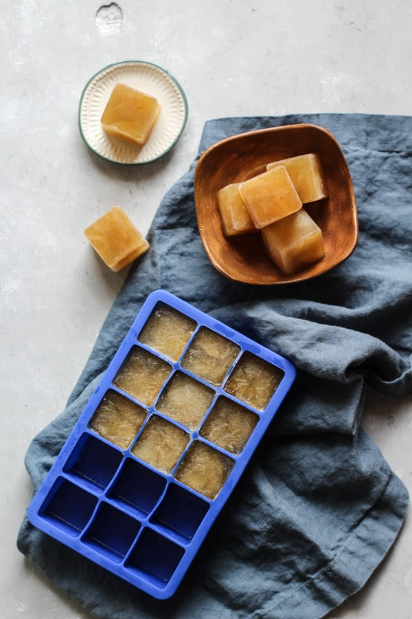Chicken bone broth ice cubes in ice cube tray