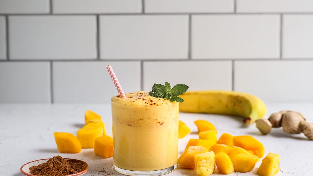 Mango lassi smoothie recipe with chai spices and fresh ginger