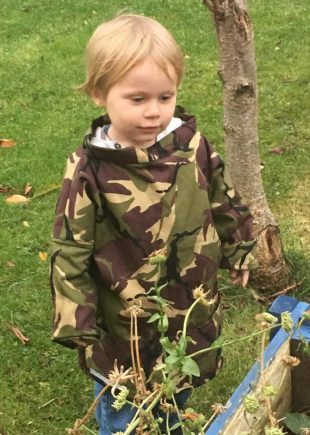 Our Rachel's gorgeous wee boy modelling our adventurer's smock