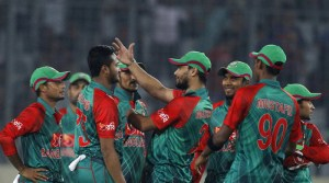 Bangladesh's Shakib Al Hasan, second left, celebrates with teammates the dismissal of Zimbabwe's Craig Ervine during their first one day international cricket match in Dhaka, Bangladesh, Saturday, Nov. 7, 2015. (AP Photo/A.M. Ahad)
