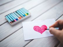 person coloring a heart