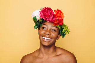 Smiling Woman with Flowers in Her Hair