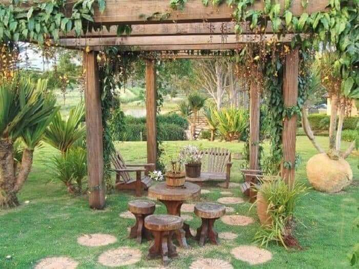 Pergola with wooden furniture