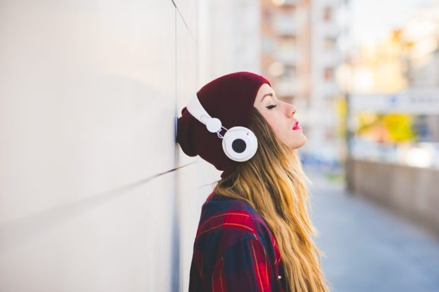 woman with head phones_ ringing ears