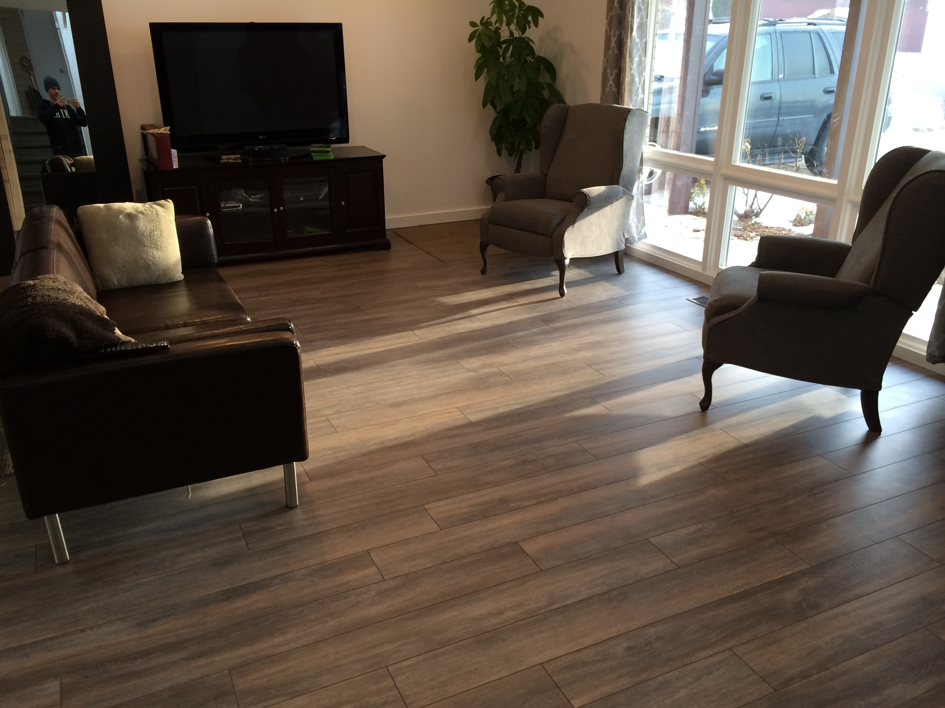 dark grey laminate flooring living room 2 cushions how to determine the direction install my