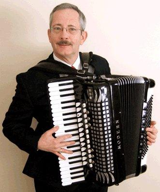 big man chairs margaritaville beach cvs detroit accordionist 1 | hire live bands, music booking