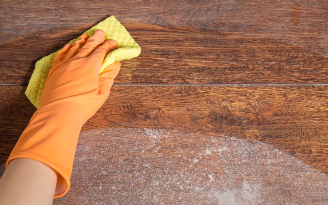 dusting wood surface with microfiber cloth