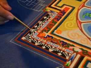Making a sand mandala. Photo Credit: Gaden Shartse Monastic College