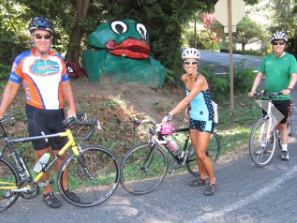Up close and personal, cyclists see the island and pause by Frog Rock