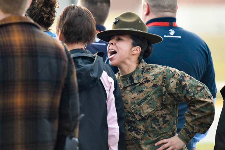 United States Marine SSgt. Carolin Chavez, barks out orders to educators from around New England during the Marine Corps Educator Workshop at Parris Island in South Carolina on Wednesday, Feb. 25, 2015. Teachers from around New England got a chance to experience what life would be like for Marine recruits during the Marine Corps Educator Workshop at Parris Island in South Carolina.