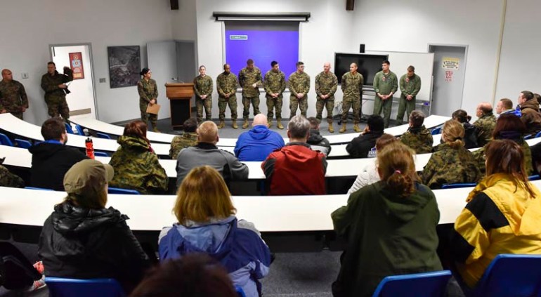 Teachers from the New England area listen to Marines from the Beaufort, South Carolina Marine base, when they got a chance to see what life would be like for Marine recruits during the Marine Corps Educator Workshop at Parris Island in South Carolina on Wednesday, Feb. 25, 2015.