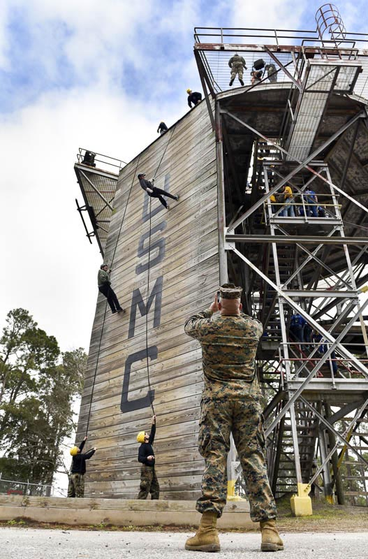 Marine Sgt. Jose Murillo takes a photo of two of the educators as they rappel off Holberton Tower during their experience of what life would be like for Marine recruits during the Marine Corps Educator Workshop at Parris Island in South Carolina on Wednesday, Feb. 25, 2015.