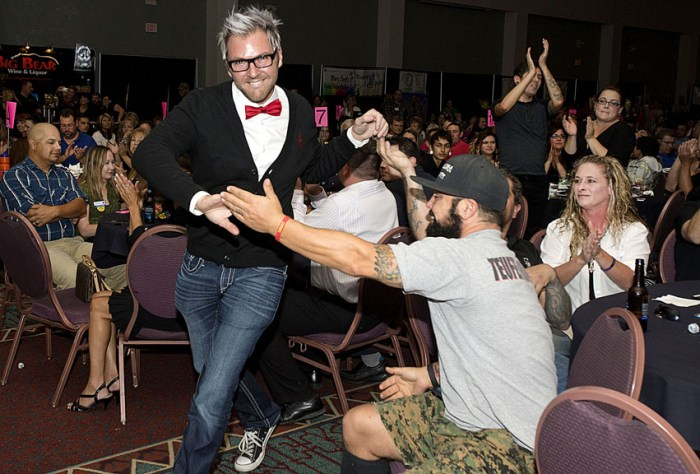 Chris Carter, right, congratulates Jeremy Mihelich of Headlines West, in red bow tie, after he was named the top winner in the stylist category during the Best of Pueblo announcement ceremony at the Convention Center on Oct. 8, 2014 in Pueblo, Colo.