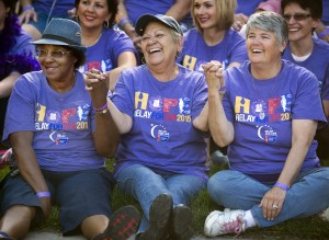 From the left, Marie Simpson, Irene Russell, and Dennie Sorwell, hold hands and celebrate the cancer surviviors' group photo prior to the start of the American Cancer Society's 2015 Relay For Life Friday evening June 5, 2015 at Pueblo Community College in Pueblo, Colo. The annual fund raising event brings together dozens of teams of walkers who walk all night to raise money to find a cure for cancer. (Bryan Kelsen, The Pueblo Chieftain)