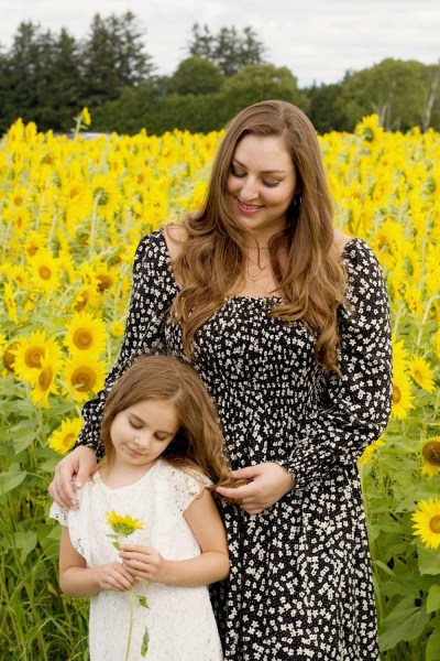 Mother and daughter in sunflower field