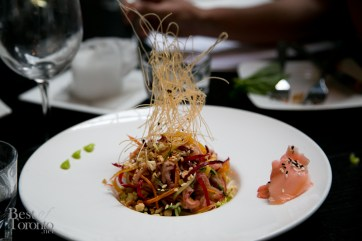 Crunchy asian salad with napa cabbage, vegetable whispers, toasted peanuts and drizzled with Asian sauce