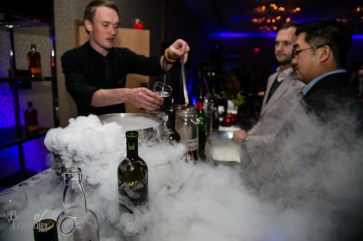 Barchef creating cocktail concoctions