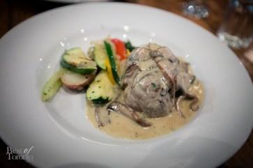 Grilled 8 oz. filet mignon in a portobello mushroom truffle cream sauce