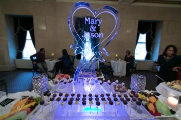 Wedding-themed dessert table with ice bar