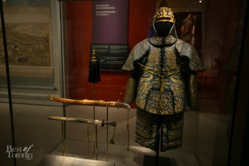 The Emperor's Ceremonial Armour and sabre from the Qing dynasty (Yongzheng period). It features cotton padding, embroidered silk satin, copper studs, and metal plates. meant for show rather than real protection.