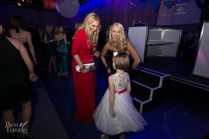 6 year old cancer patient, Sara Jean, dancing and mingling with guests at POGO