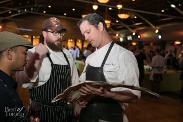 Oliver & Bonacini's Corporate Executive Chef Anthony Walsh examining some goods