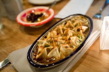 Turkish Manti Dumplings with smoky eggplant, yogurt sauce and molasses