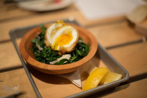 """Run DM Caesar"" with collared greens and a perfectly cooked scotch egg"