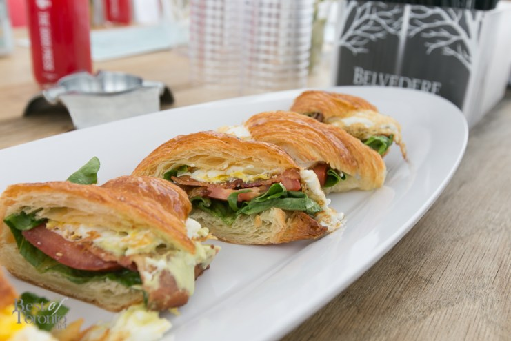 Applewood-Smoked Bacon and Fried Egg Sandwich with an O&B Artisan Croissant, lettuce, tomato, avocado mayo. Served on the menu with sweet potato fries.