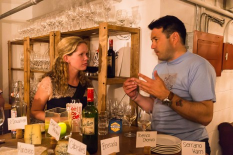 Nicholas Hammenken chatting with guest about his wine