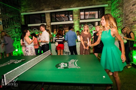 Playing ping pong with one of the Perrier girls