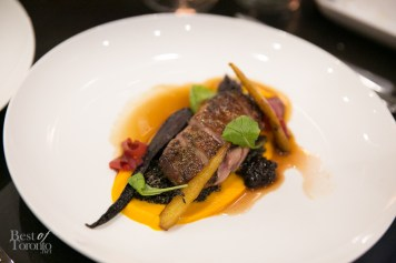 Roasted dry aged duck breast with coriander, carrot, mustard, greens, quinoa, and Saskatoon berries