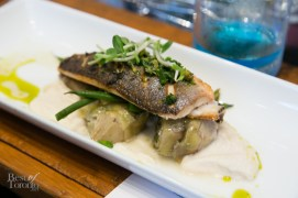 Fresh herbs, roasted branzino (Mediterranean seabass), roasted cauliflower puree, braised artichokes