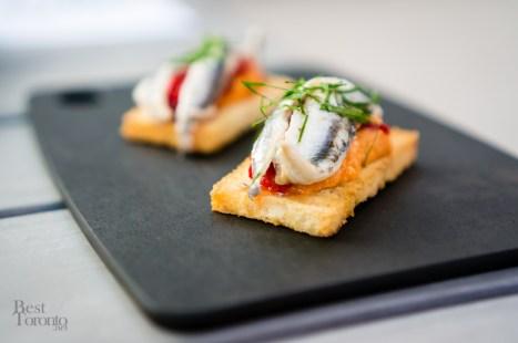 Marinated White Anchovy on Crostini, Piquillo Pepper, Romesco