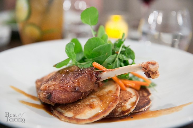 Crispy duck leg on a bed of fluffy pancakes