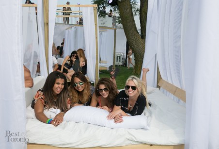 Enjoying the full VIP service in a cabana bed