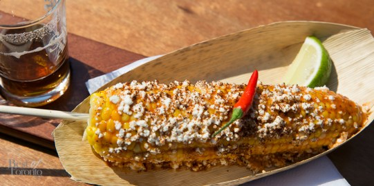 A fully dressed Mexican Elote corn on the cob by CORNehCopia