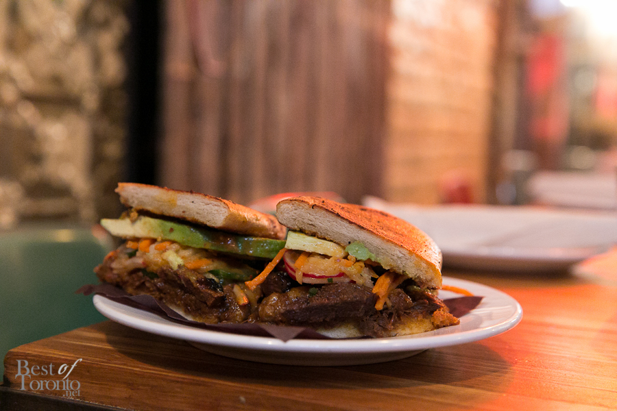 Torta Coreana with grilled kalbi beef and braised short rib, avocado, house kimchi, pickled pear and escabeche   Photo: Nick Lee