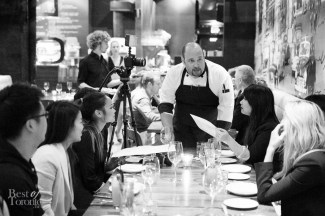 Chef Davide Ianacci speaking with guests