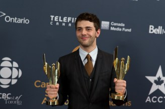 Xavier Dolan (Direcdtor Mommy) shows his two awards